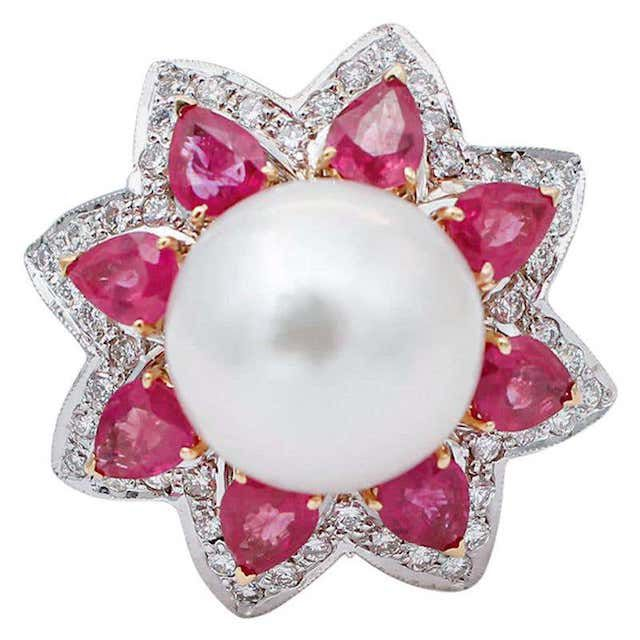 pearl ring with ruby details