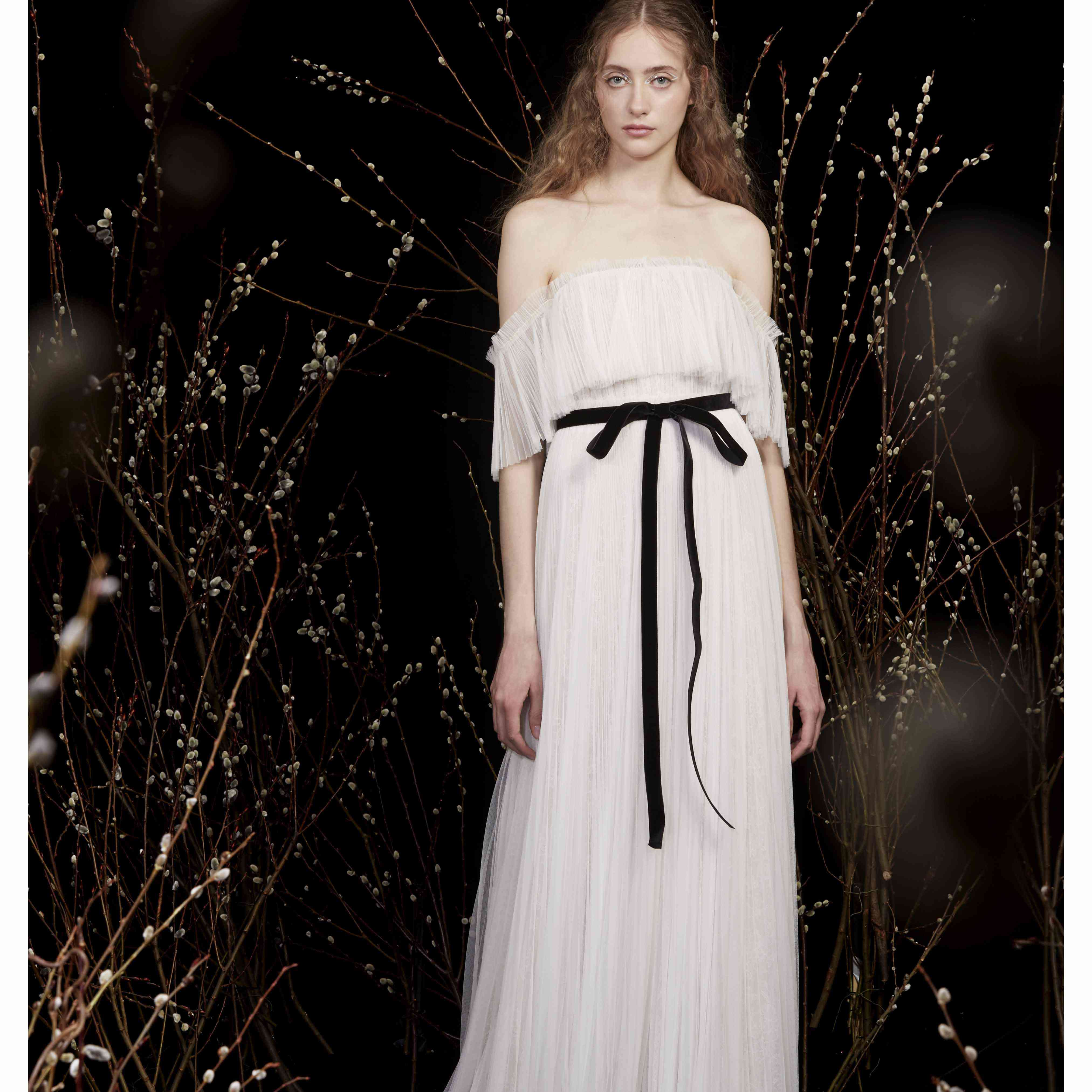 Model in off-the-sleeve wedding dress