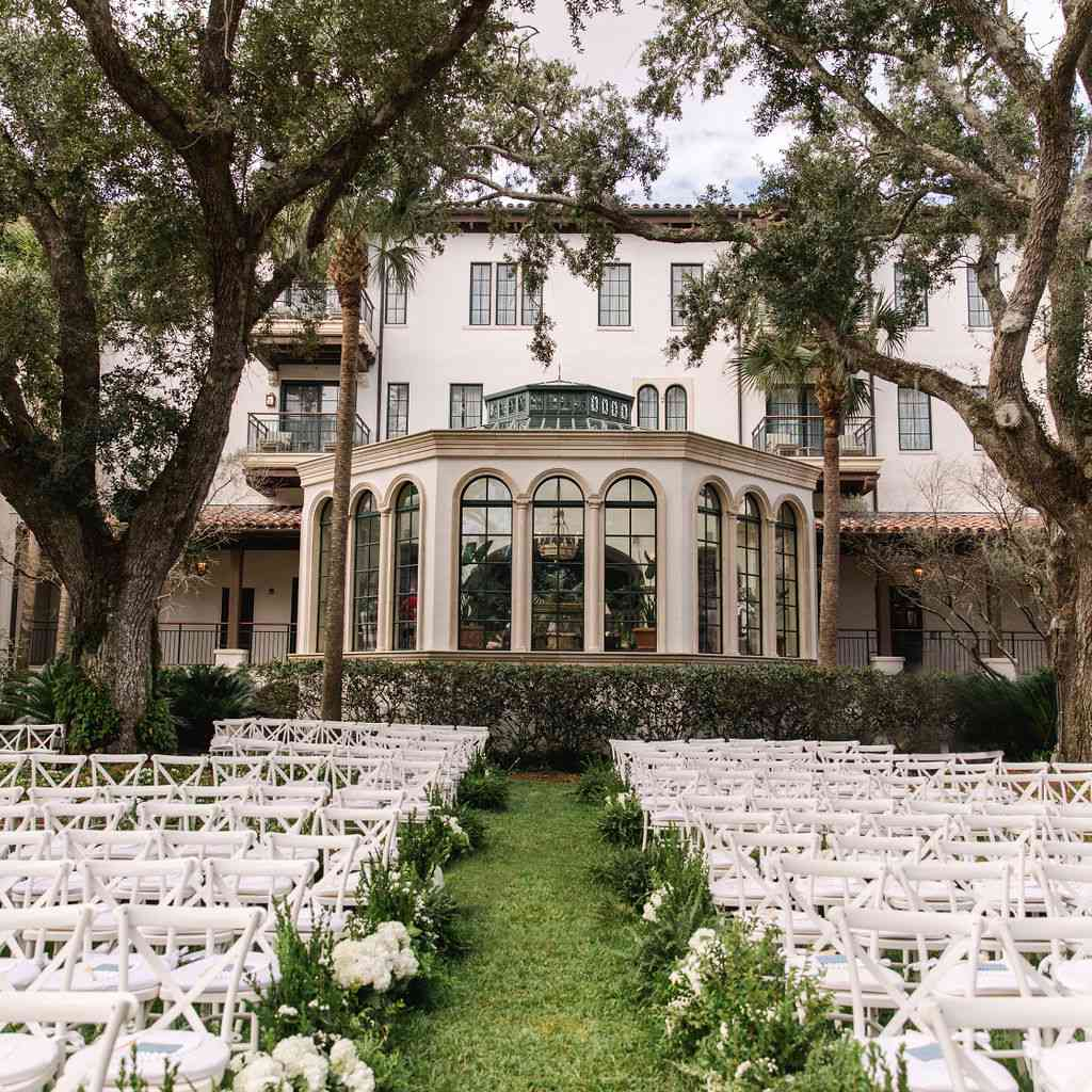 timeless southern wedding, outdoor ceremony white chairs