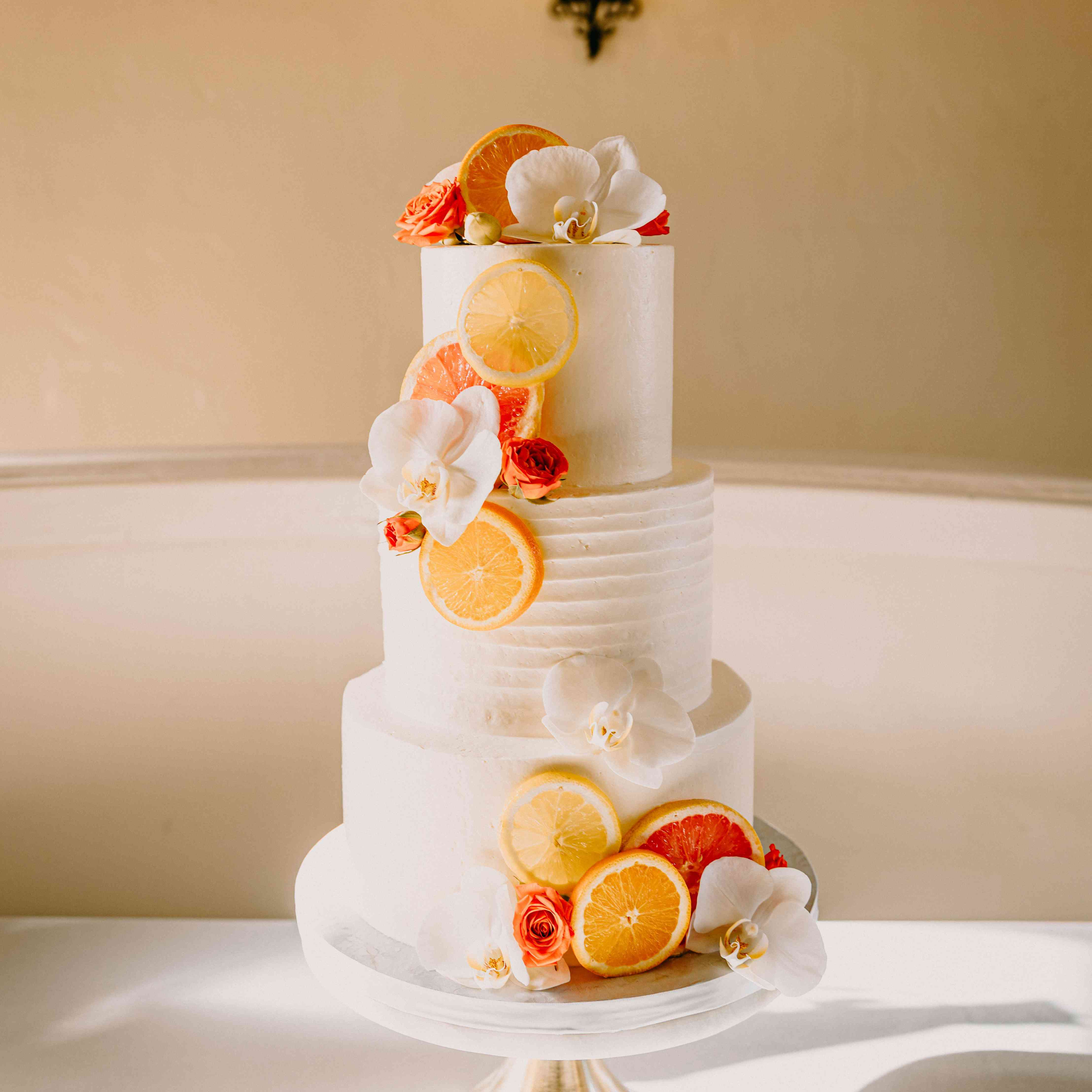 Wedding cake with flowers and citrus