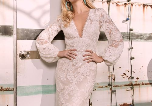 Model in long-sleeve V-neck lace gown