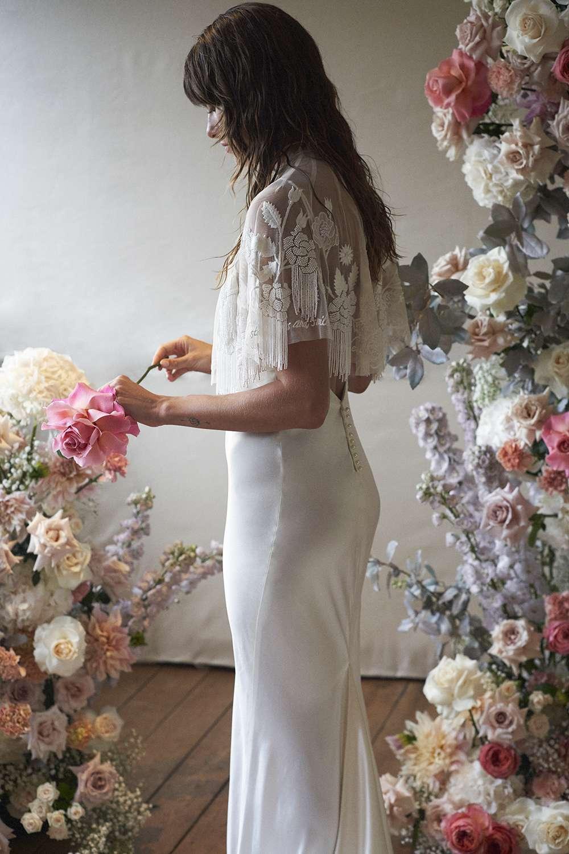 Model in fringed wedding dress