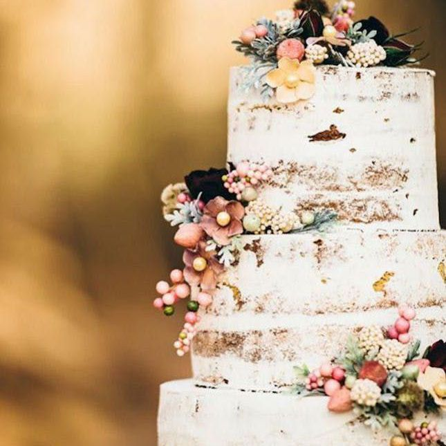 Naked wedding cake with fall flowers