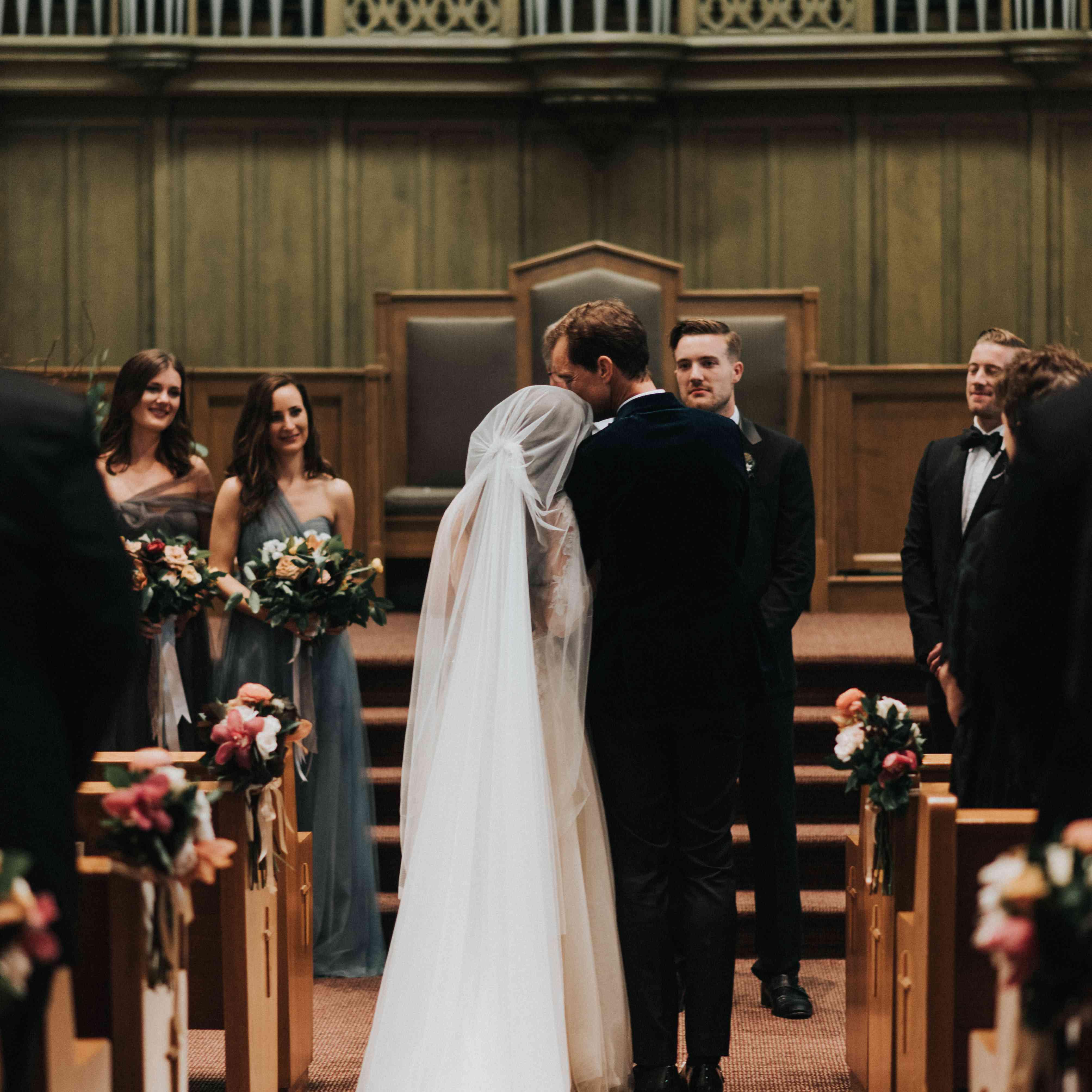personalized michgan wedding, bride and groom at church altar