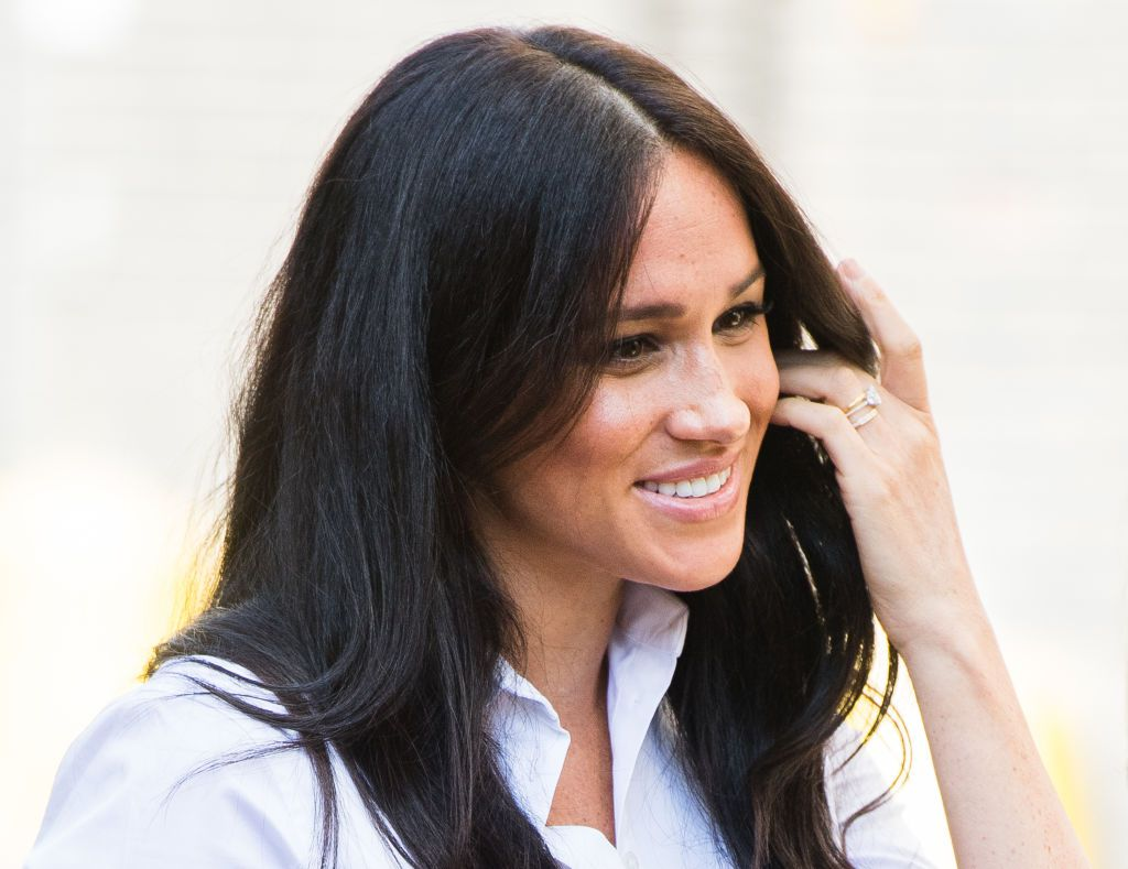 Meghan Markle with redesigned engagement ring, wedding band, and eternity band