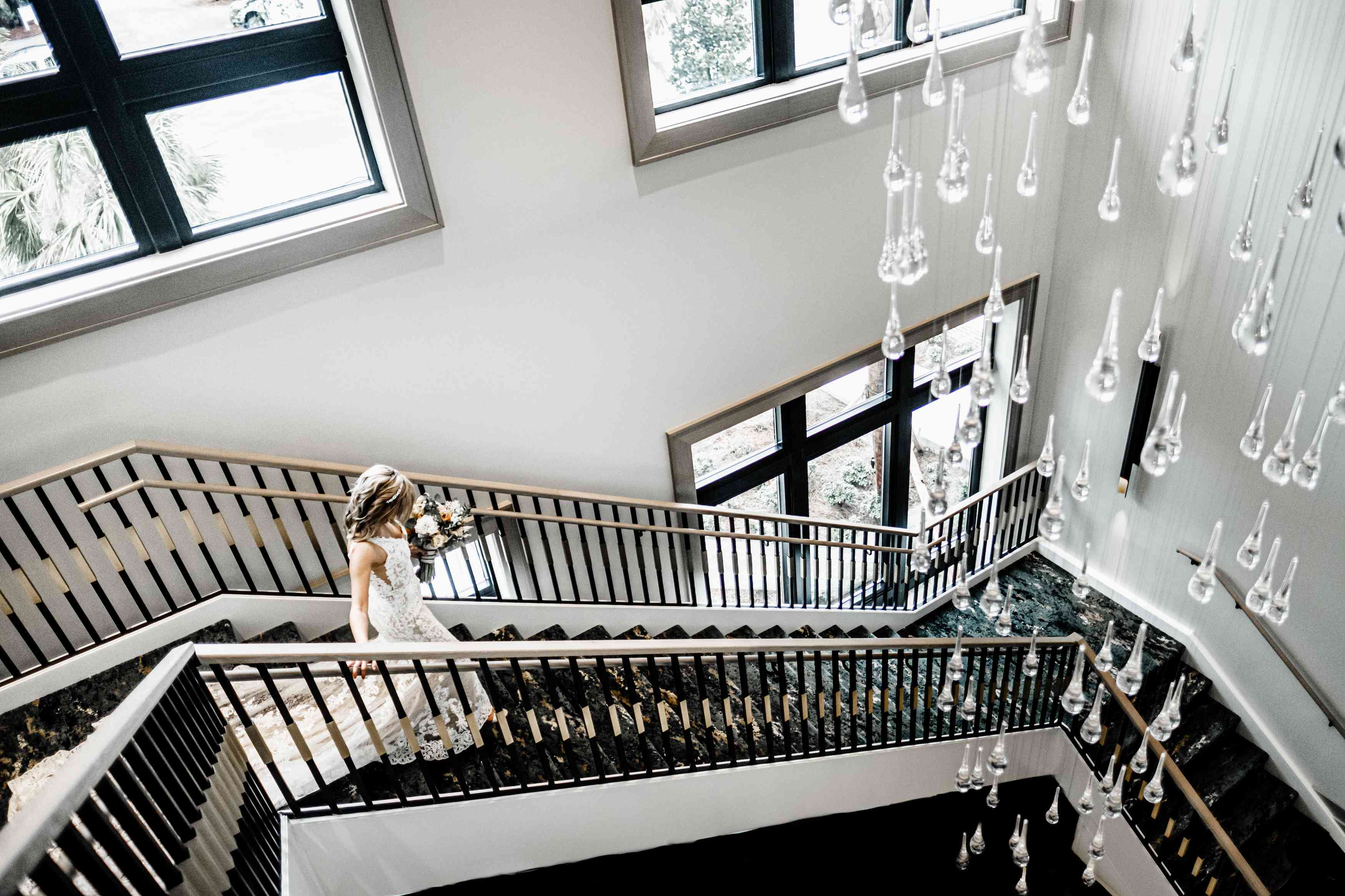 Bride walking down the Grand Staircase at Hotel Effice