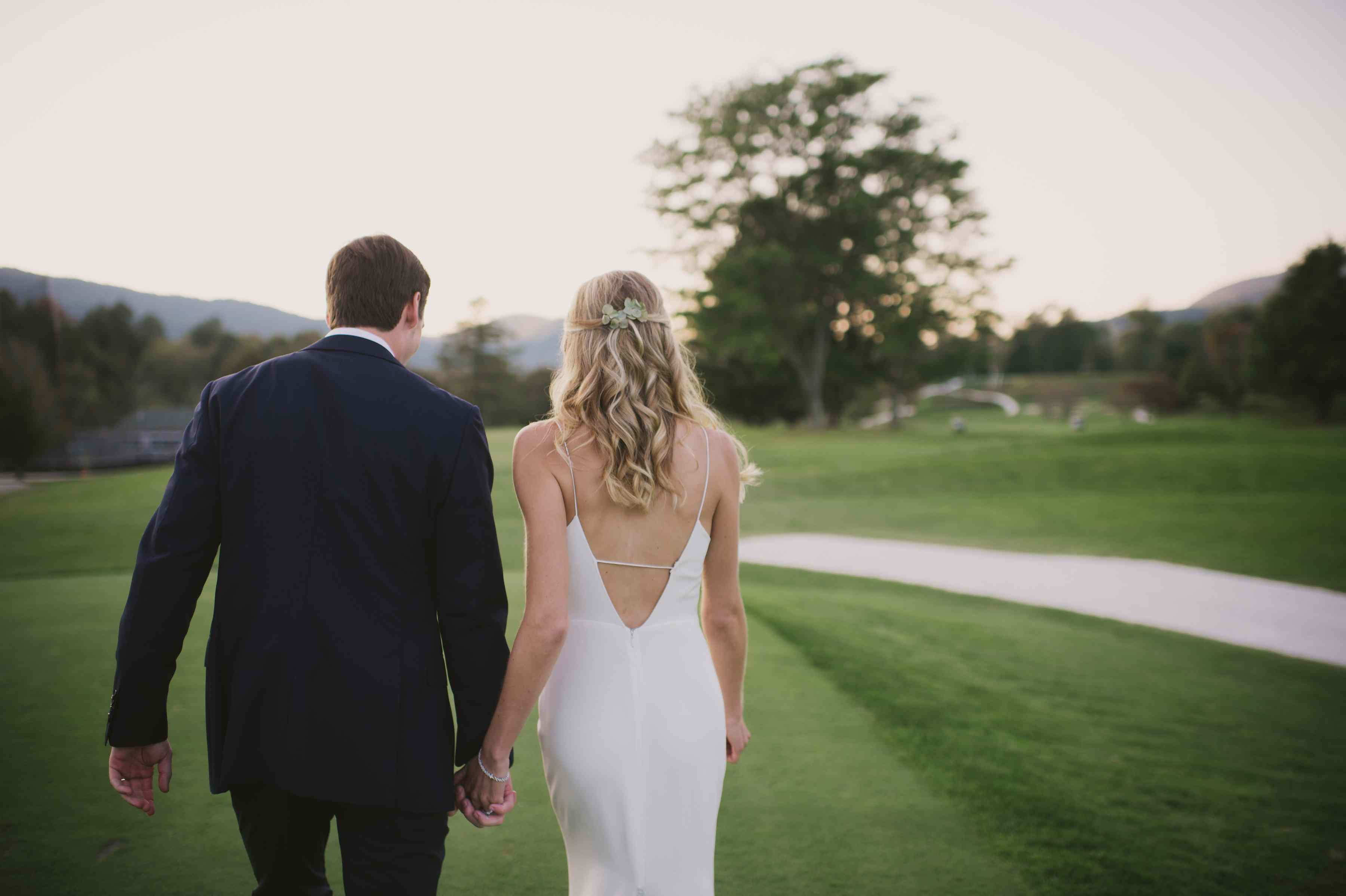 <p>bride and groom on golf course</p><br><br>