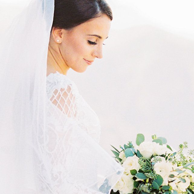Solo shot of bride with bouquet