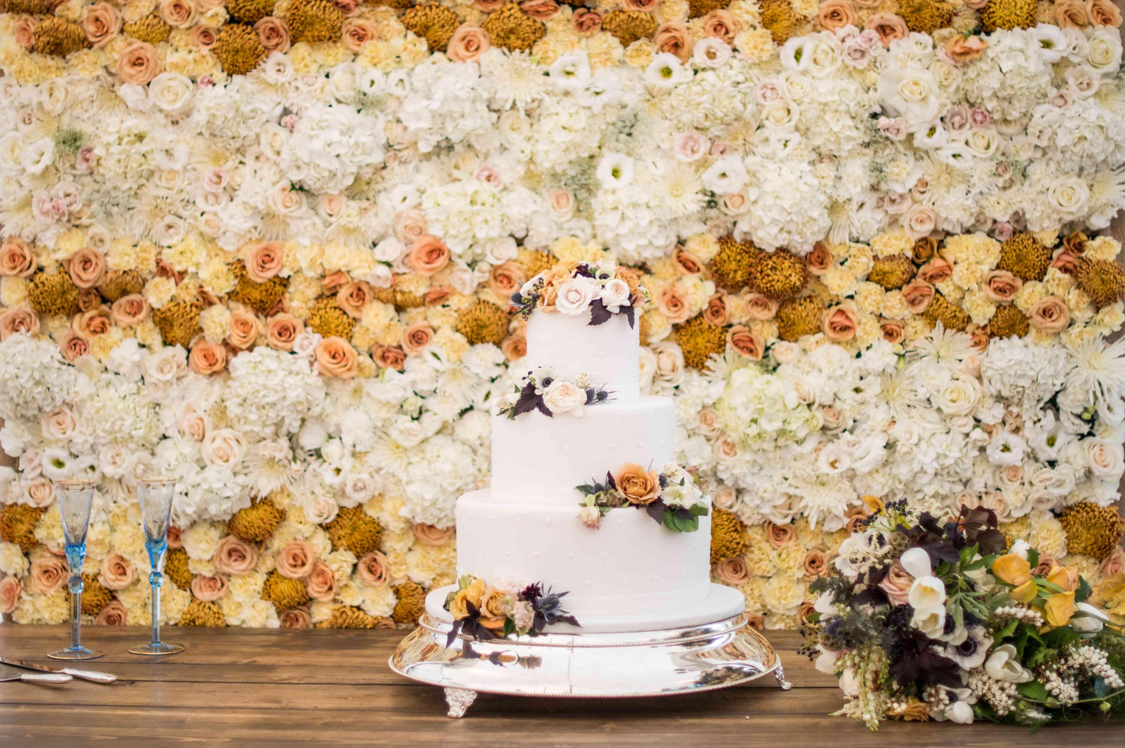 Three-Tiered White Wedding Cake with Fresh Flowers