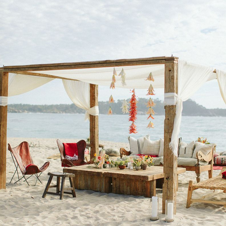 Outdoor beach seating under a canopy