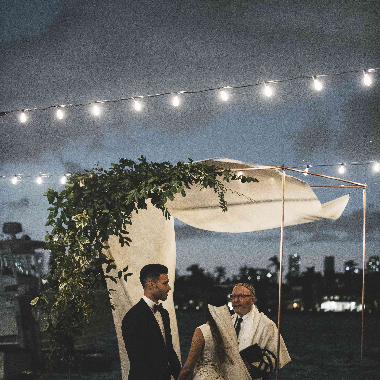 evening ceremony bride and groom under chutzpah