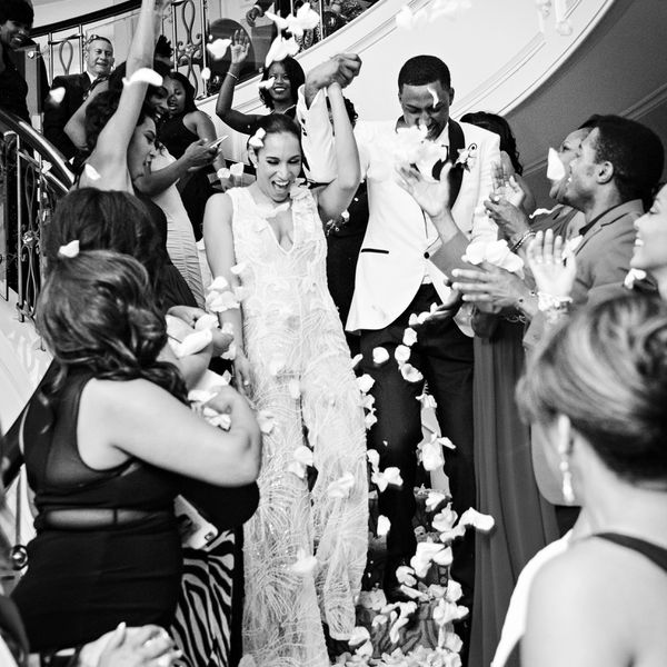 Guests throwing pedals for newlyweds