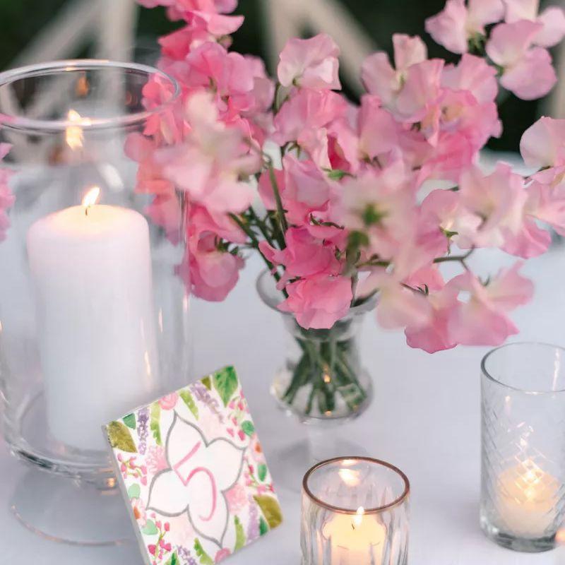 Pink sweet pea flowers in a vase
