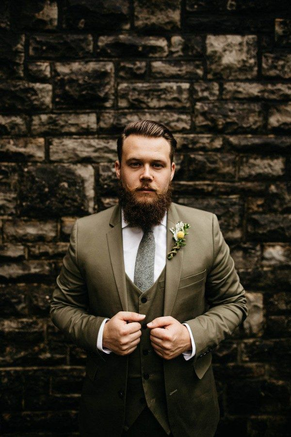 Groom in an olive green suit