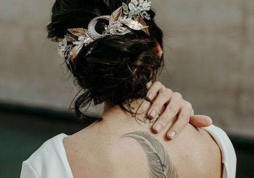 Ethereal bride with tattoo down back spine