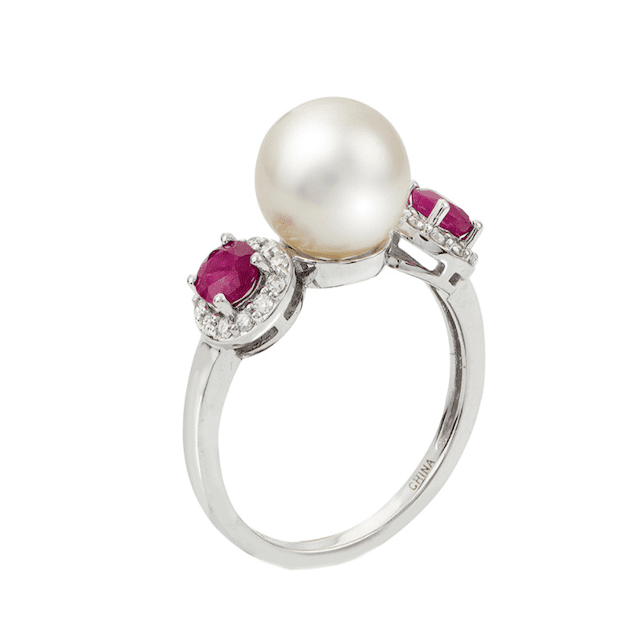 pearl ring with ruby accents and a gold band
