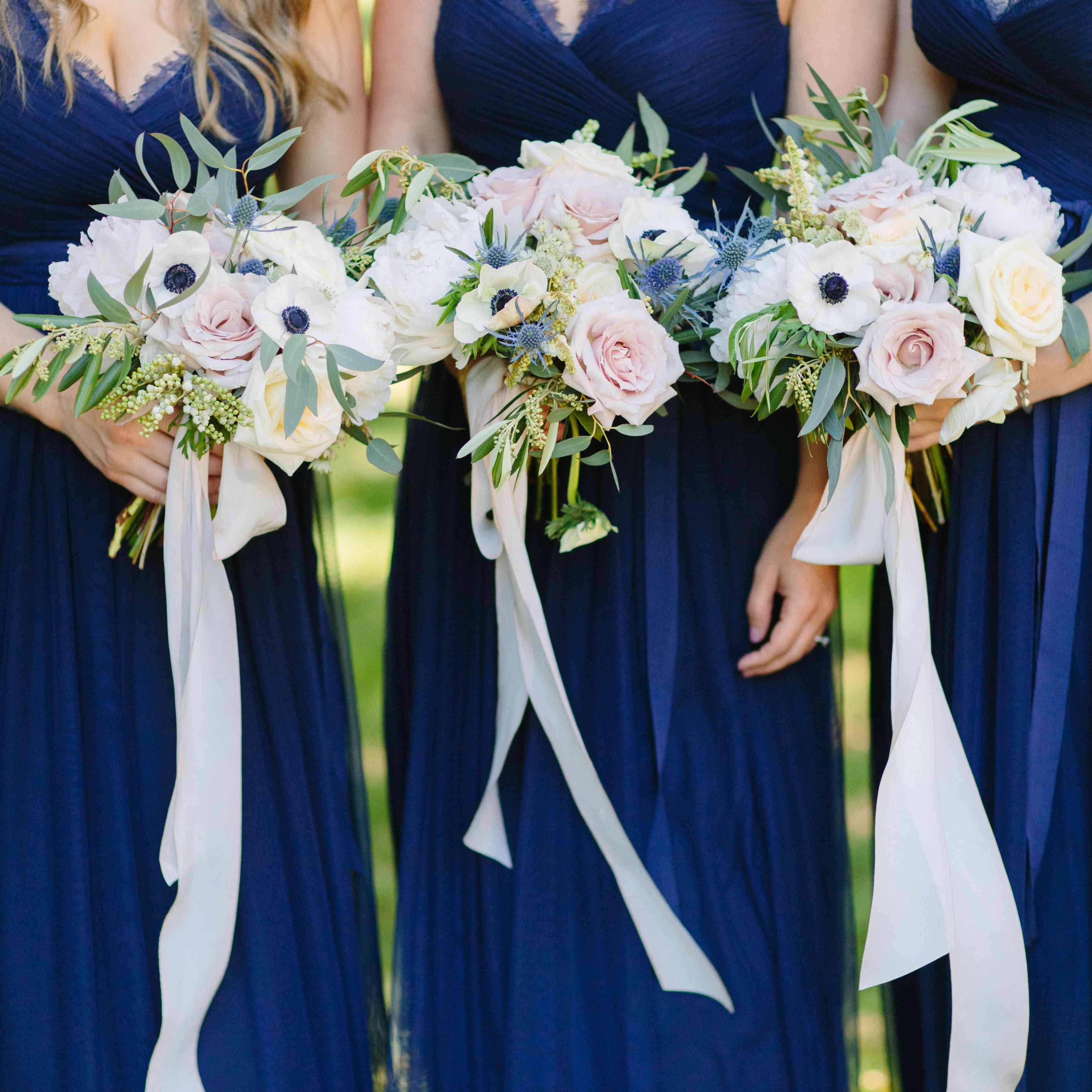 Bridesmaids holding bouquets