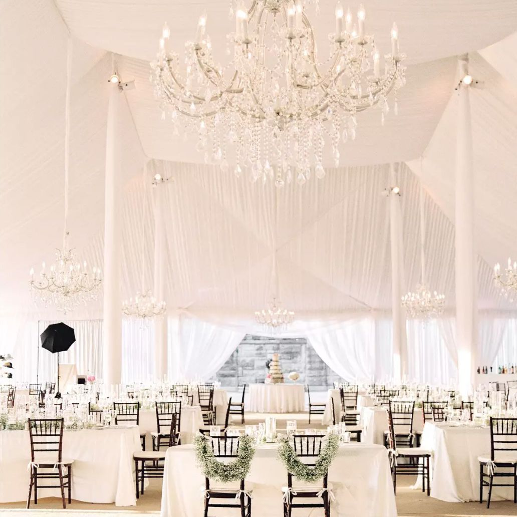 White sweetheart table with baby's breath chair adornments