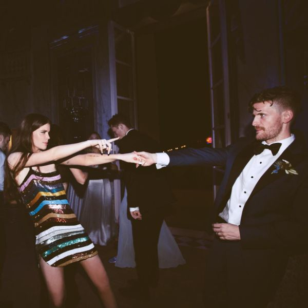 Woman and man dancing at a wedding reception