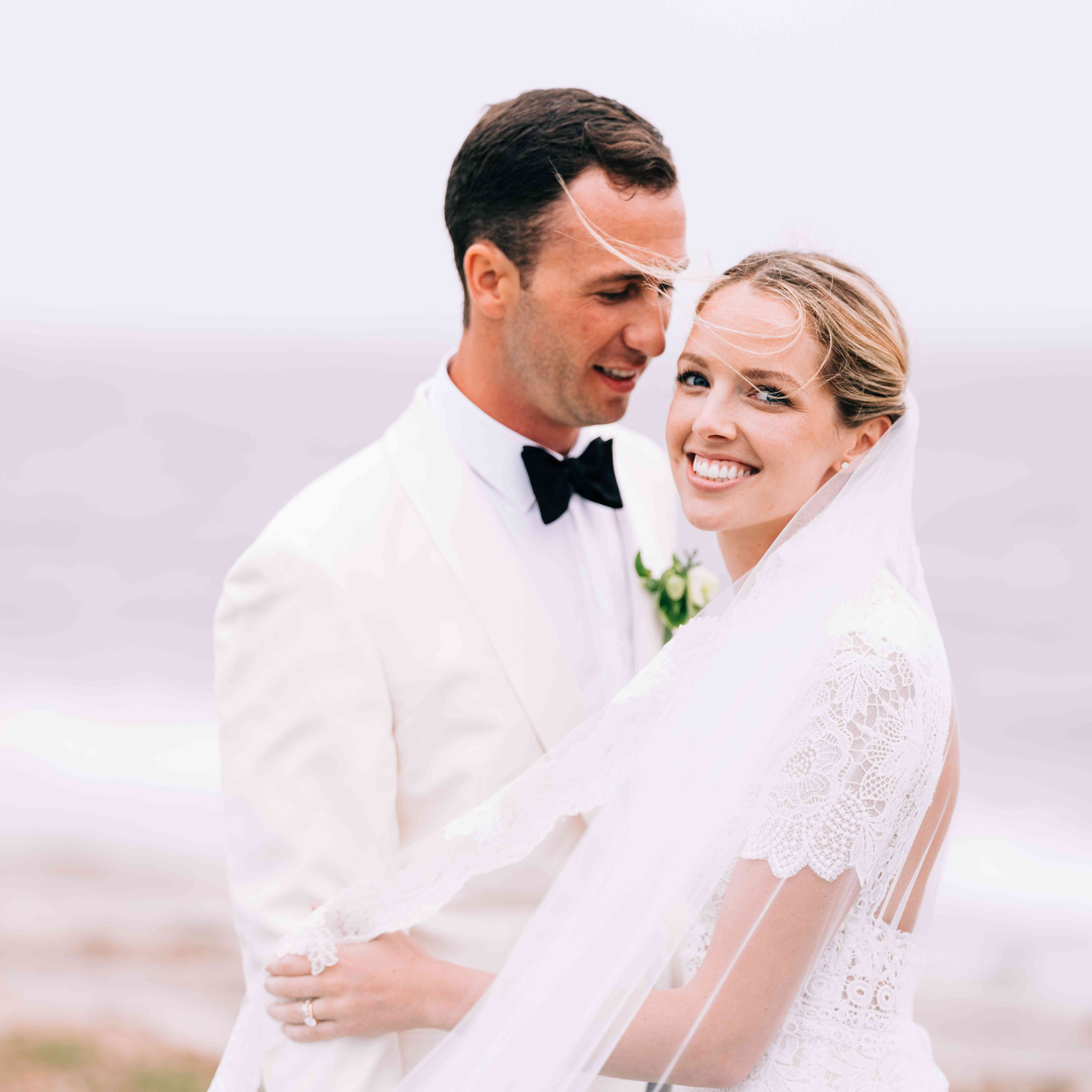 <p>bride and groom in white jacket</p><br><br>