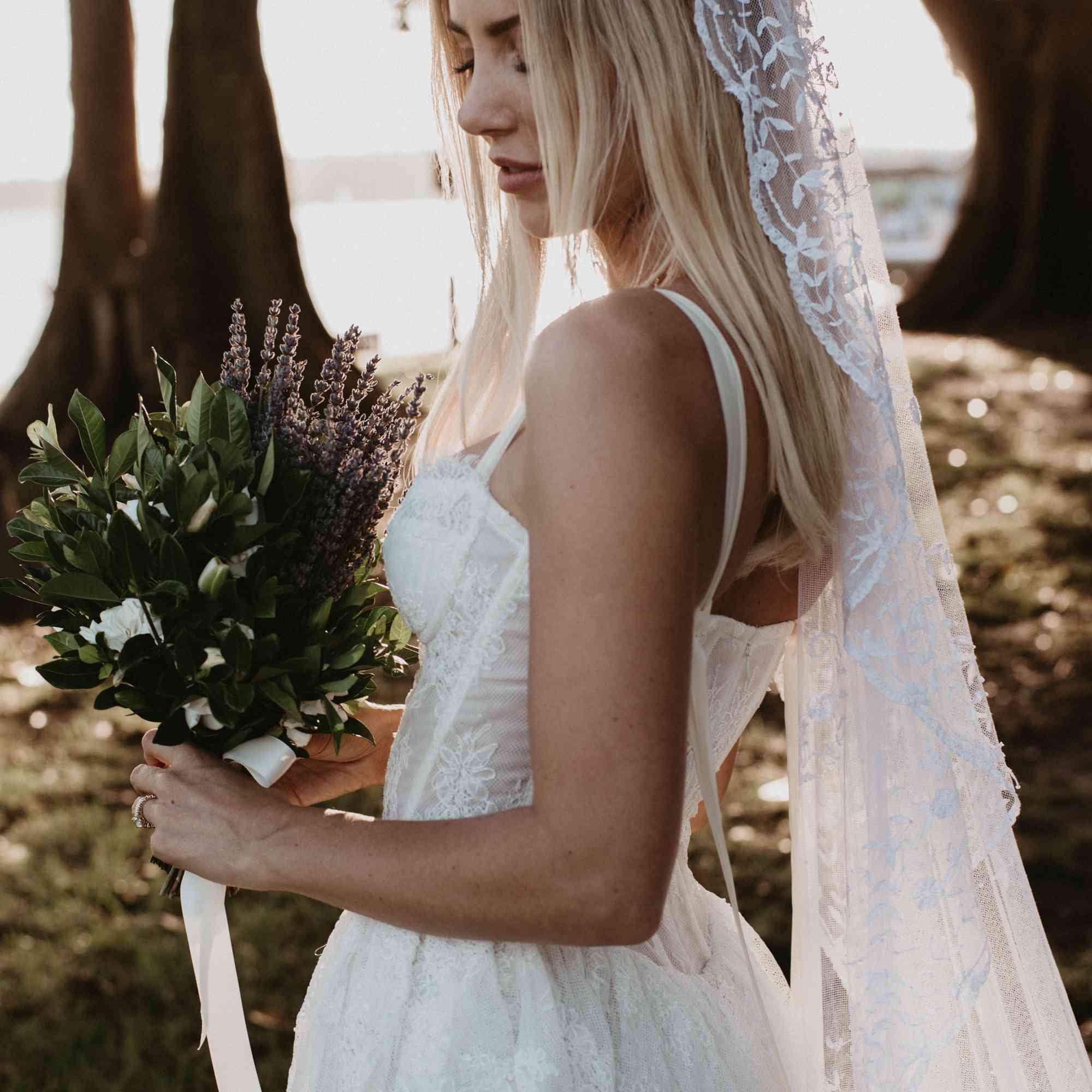 Bride wearing veil and holding flowers
