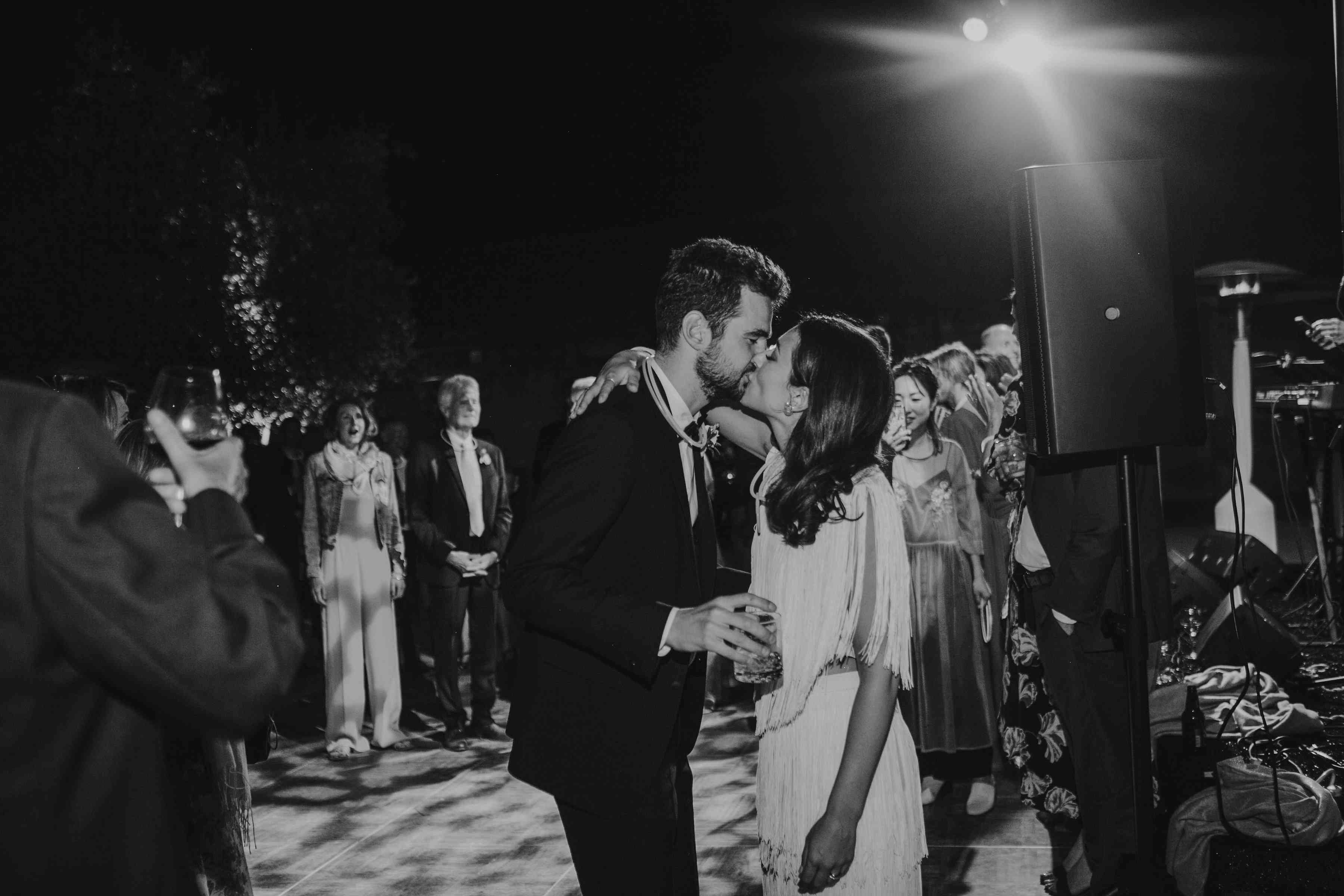 <p>bride and groom kissing on dance floor</p><br><br>