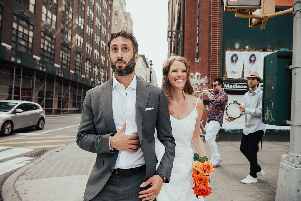 bride and groom walking in street
