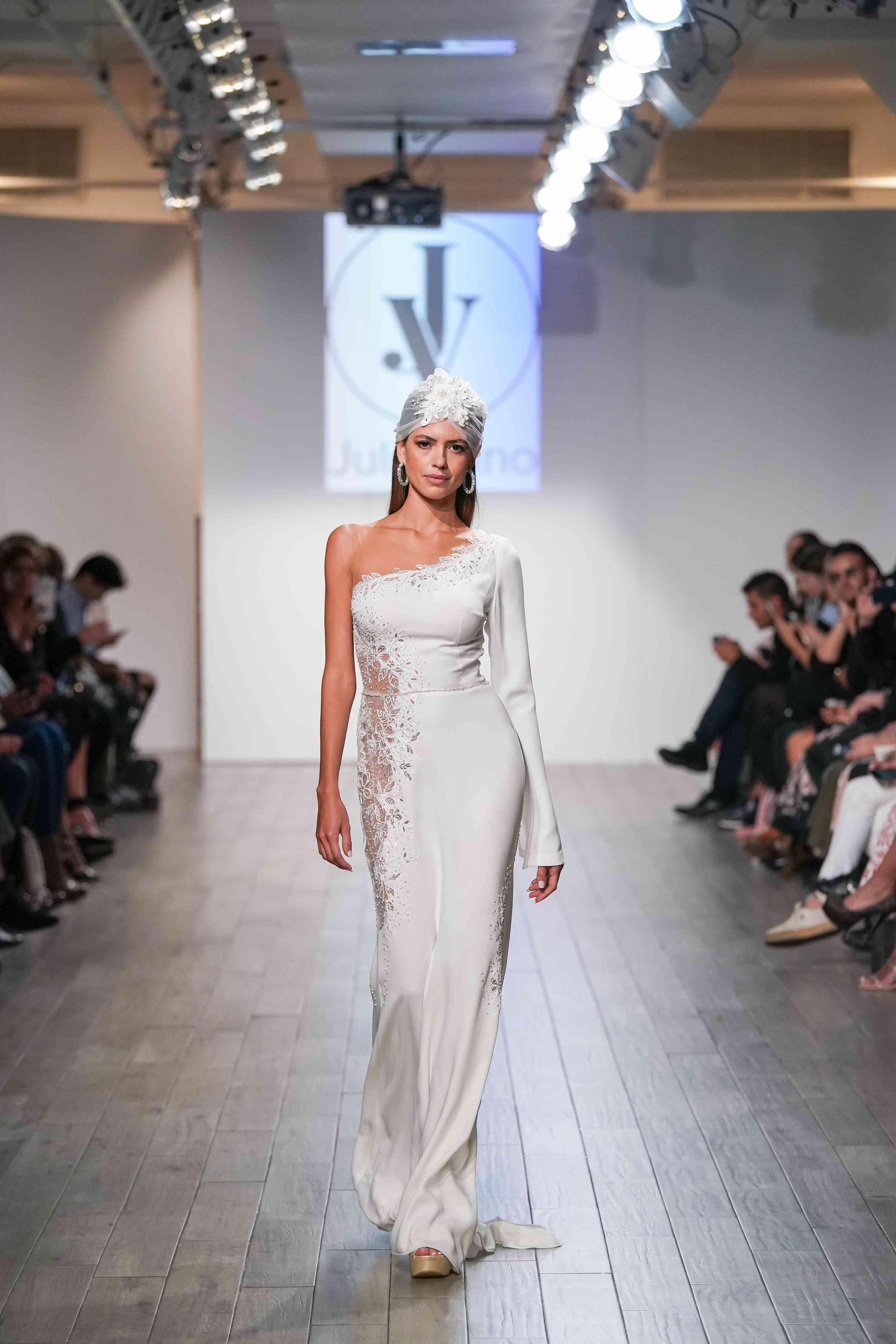 Model in one-shoulder long sleeve wedding dress