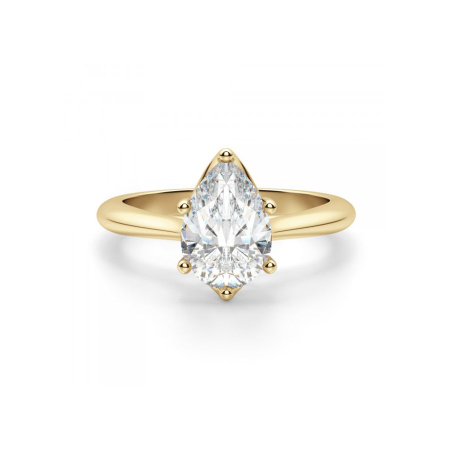 Pear diamond engagement ring with yellow gold band on a white background.