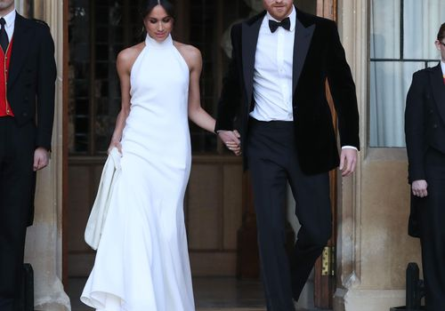 Meghan Markle and Prince Harry holding hands on their wedding day