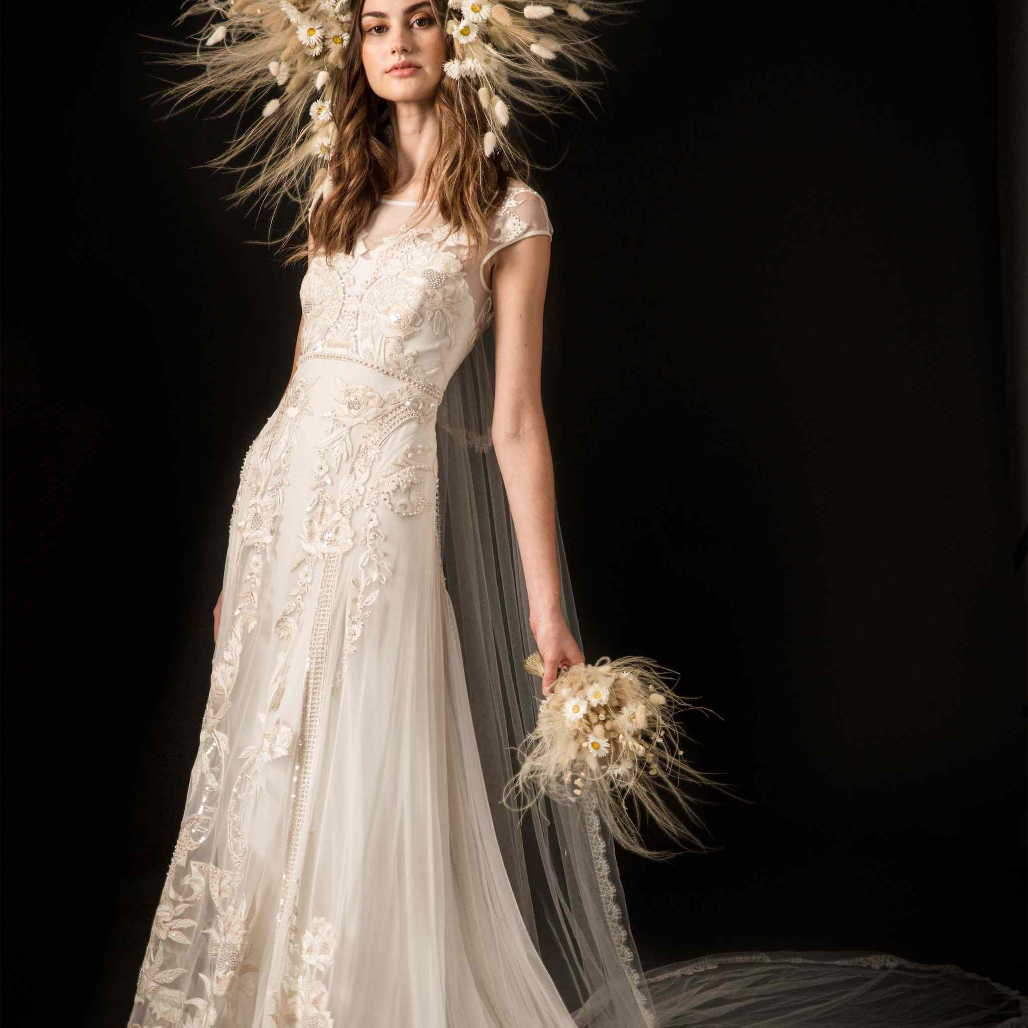 Model in beaded and embroidered tulle column dress with cap sleeves