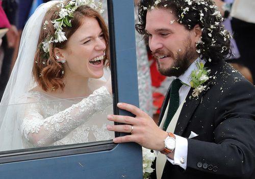 Kit Harrington and Rose Leslie leaving their wedding.