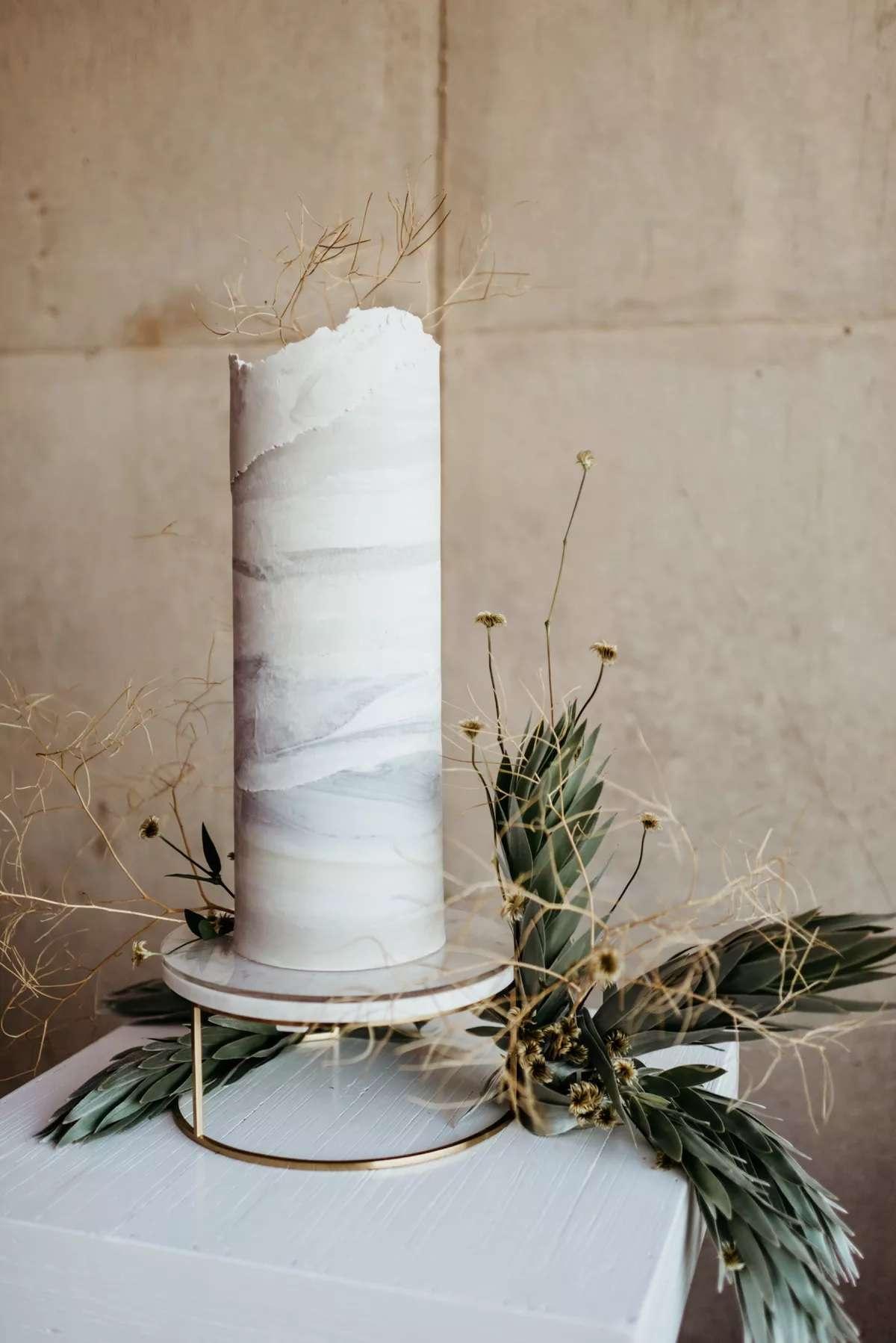 Tall wedding cake with greenery
