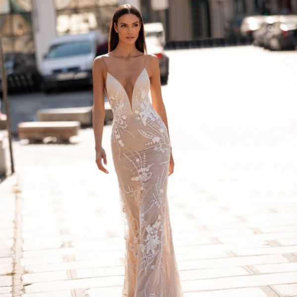 Model in illusion neckline embroidered wedding gown