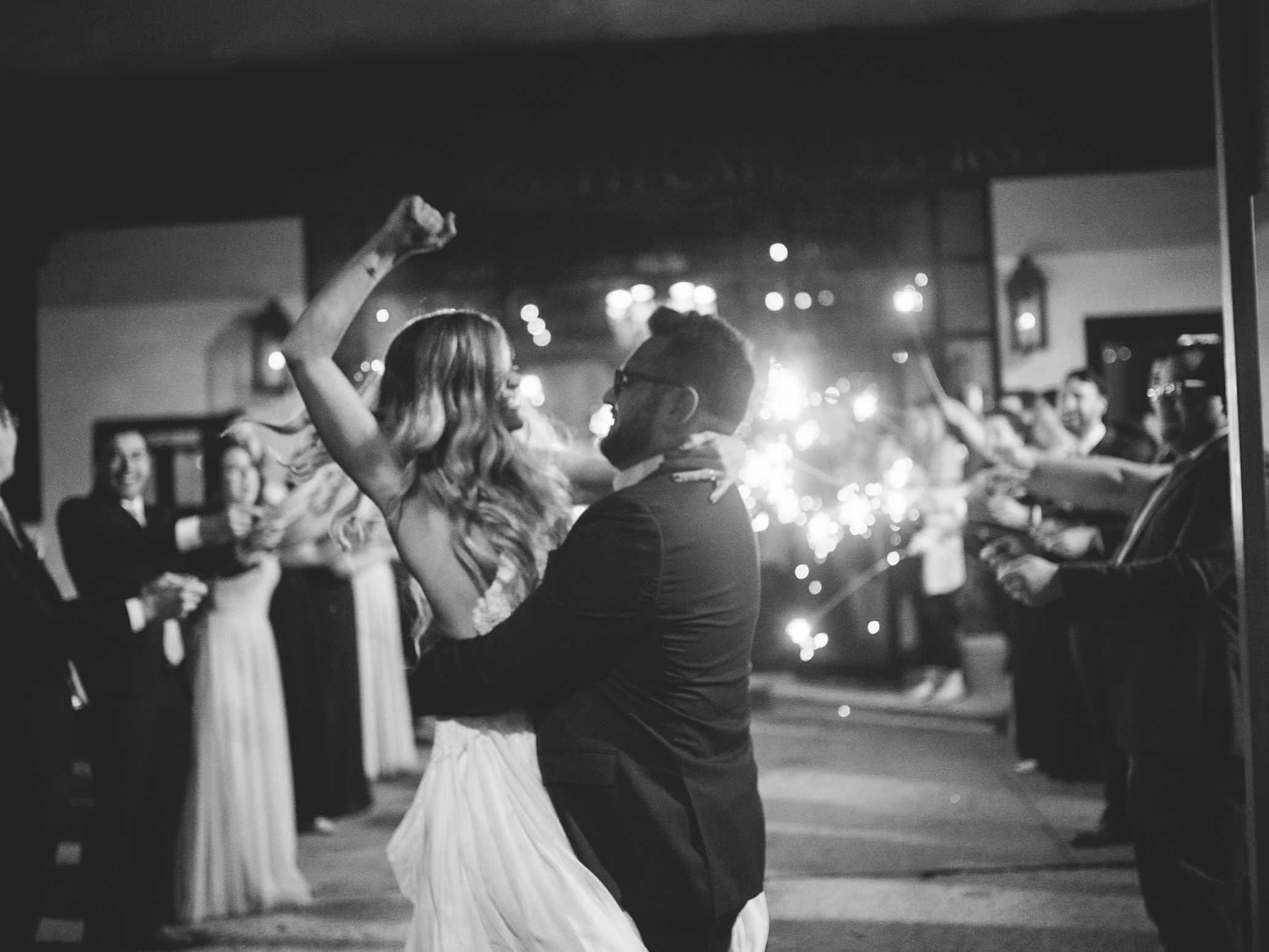 whimsical savannah wedding, groom holding bride