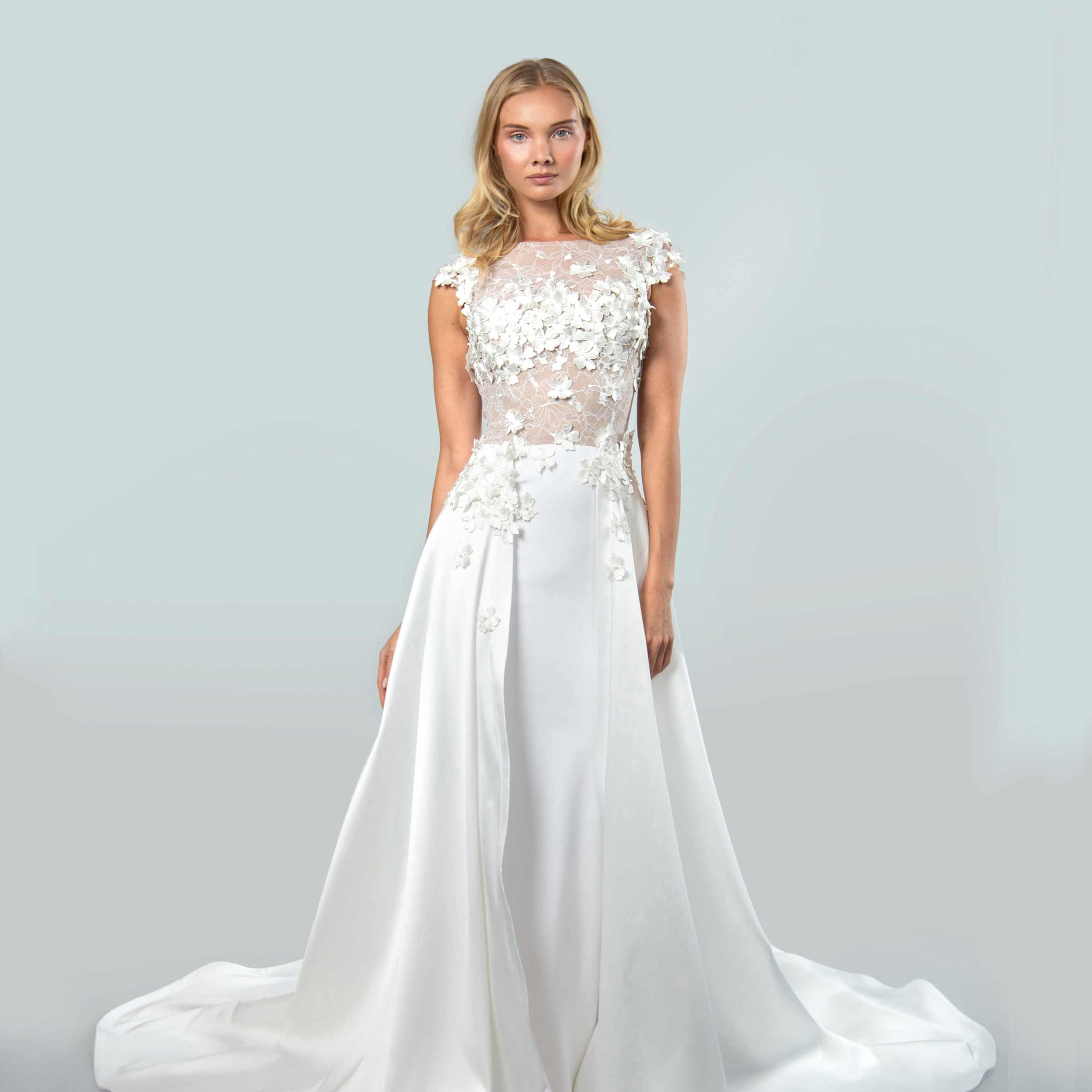 Model in bateau neckline with cap sleeves wedding dress