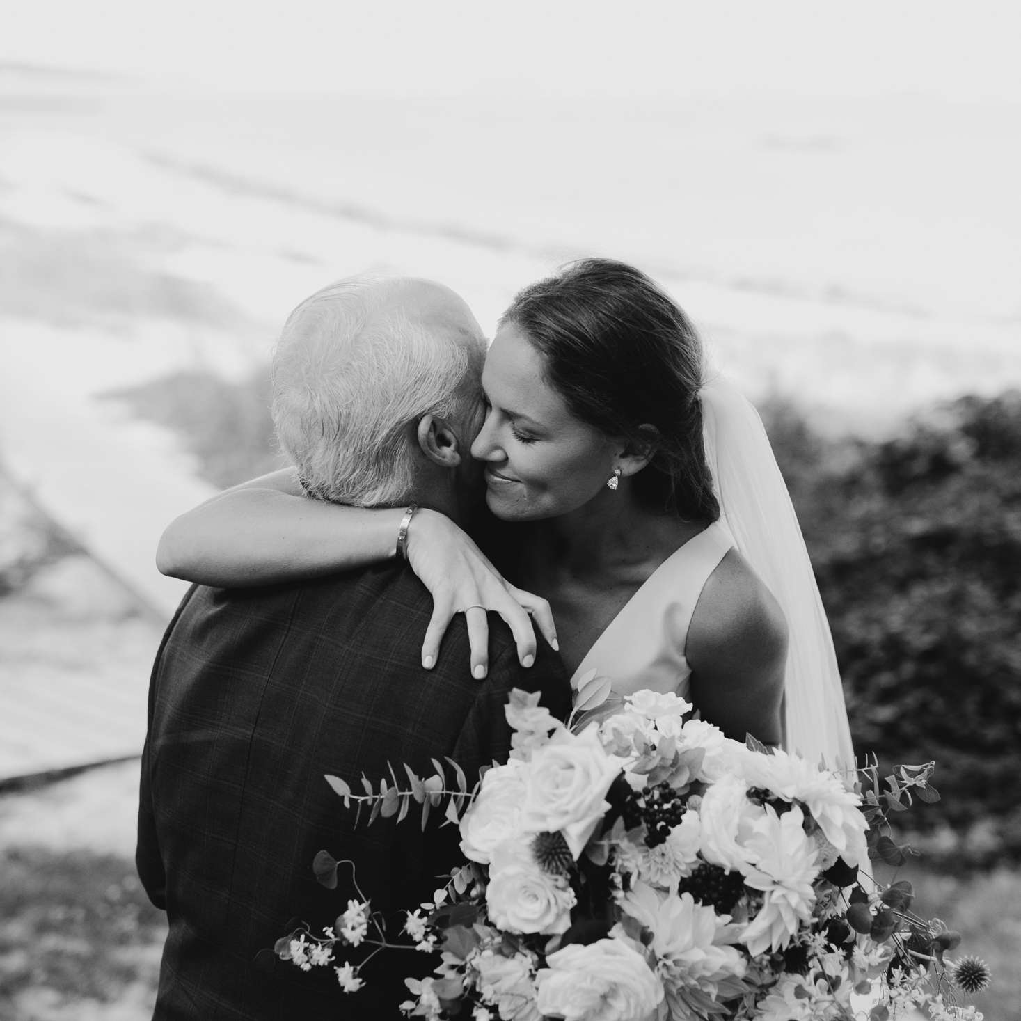 at-home rustic massachusetts wedding, bride hugging father