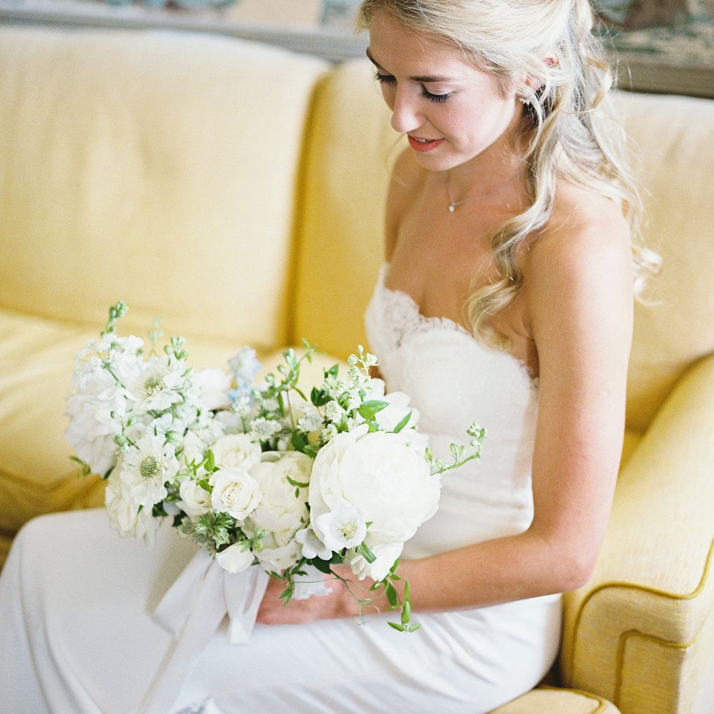 bride sitting down with bouquet