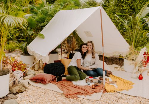 Kaila & Erica in their surprise backyard honeymoon tent