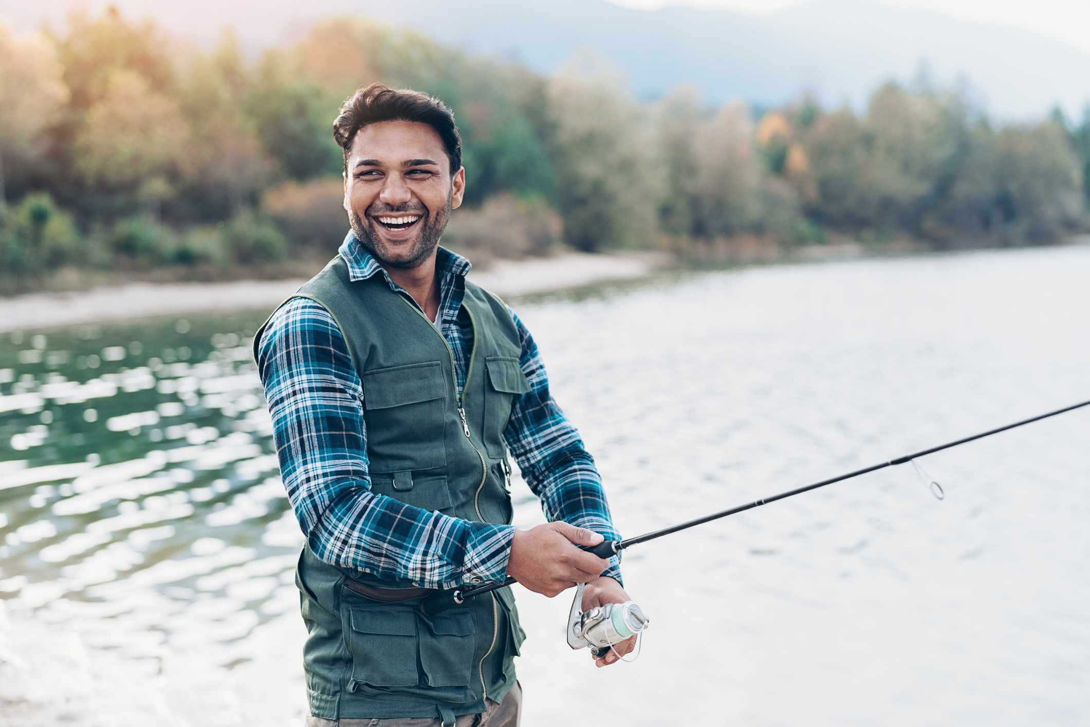 Man smiling and fishing