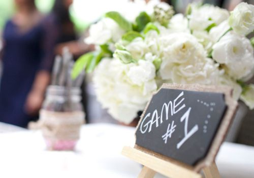 """Table at bridal shower with """"Game #1"""" sign"""