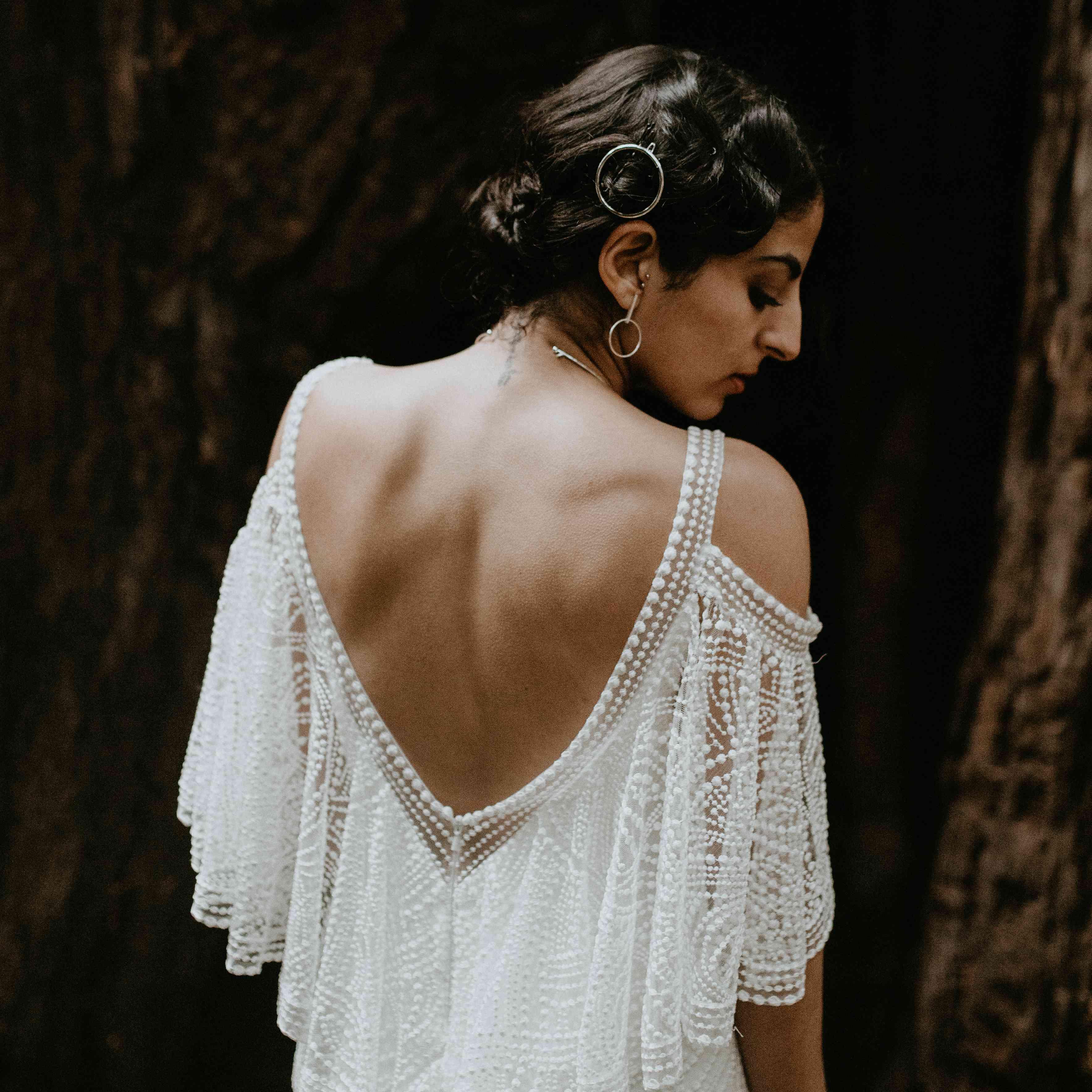 <p>low back tadashi shoji wedding dress</p><br><br>