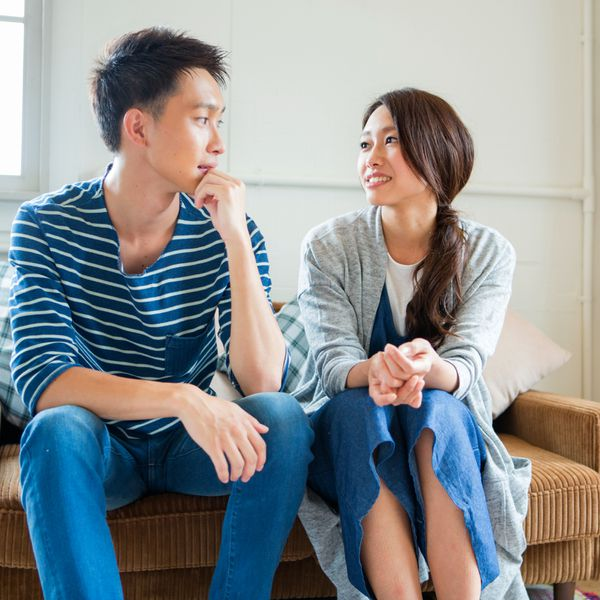 Man and woman conversing on the couch