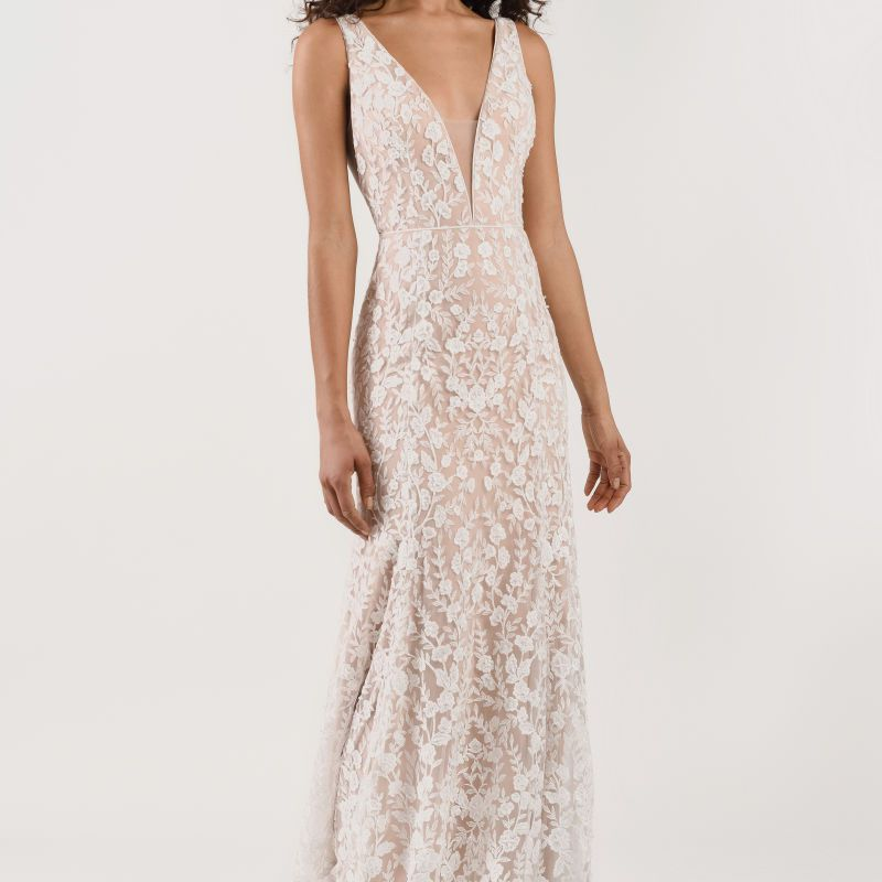 Model in long lace wedding gown with nude lining