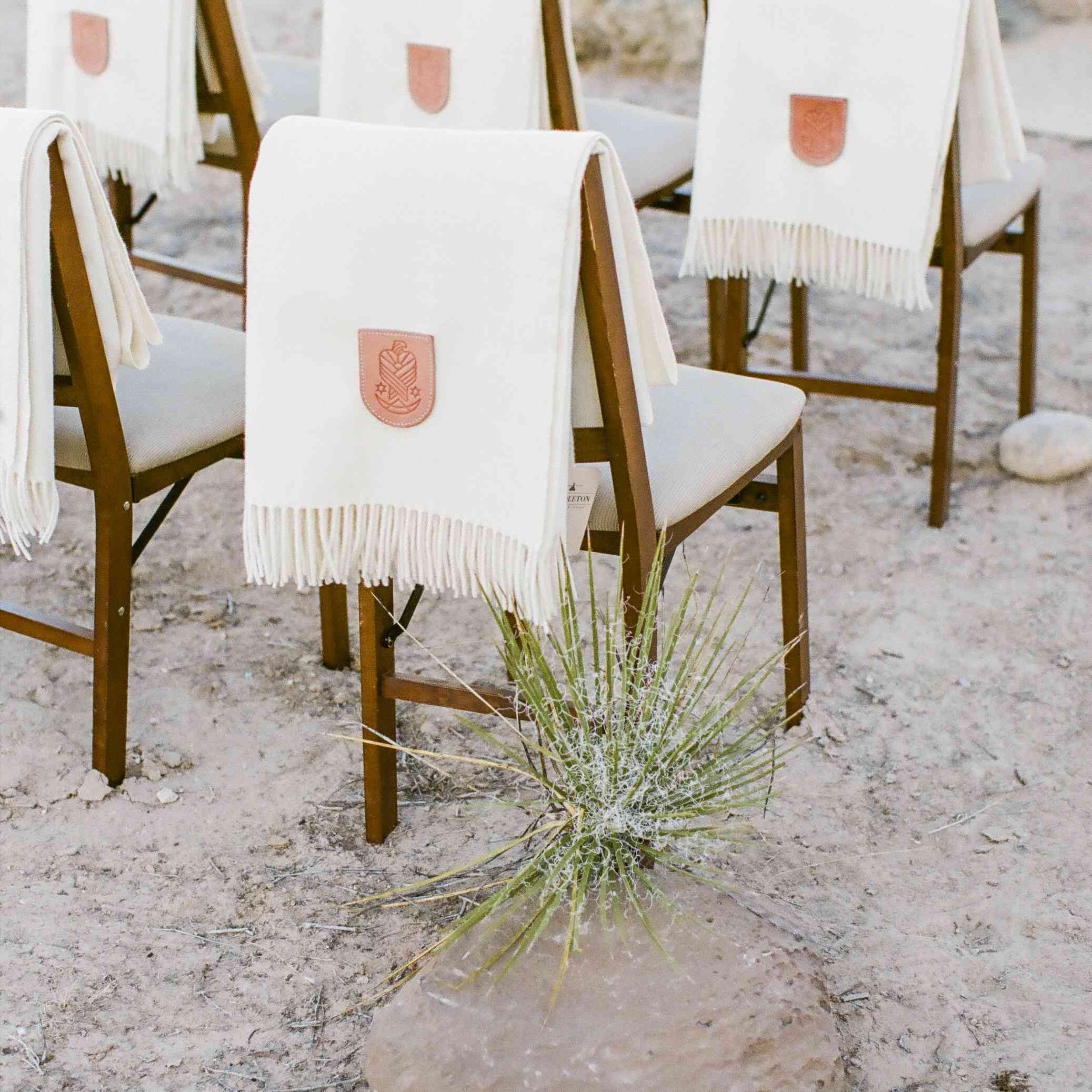 Warm blankets for outdoor ceremony seating in the fall or winter