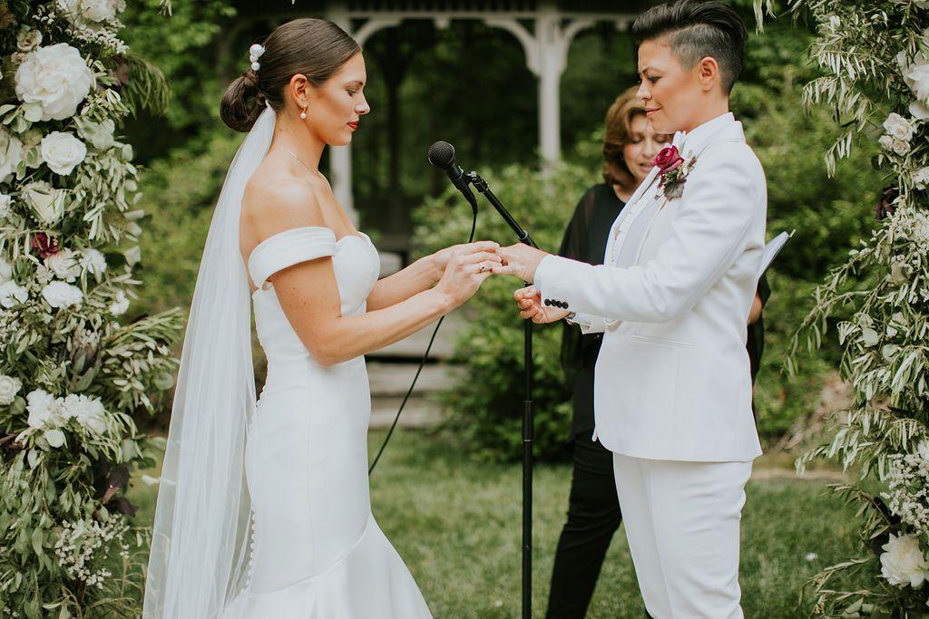 The couple exchange wedding rings