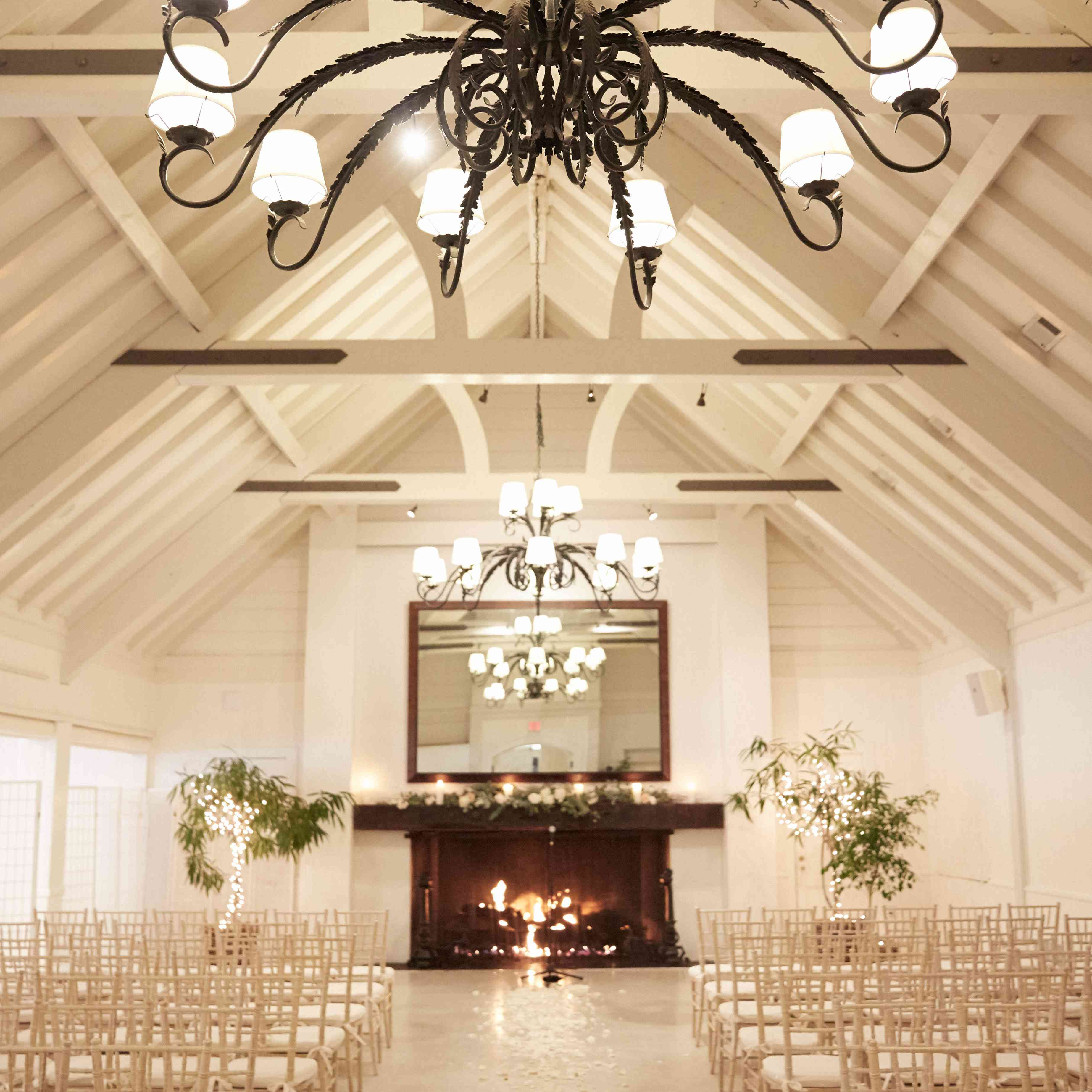 <p>White Ceremony Space with Fireplace</p><br><br>