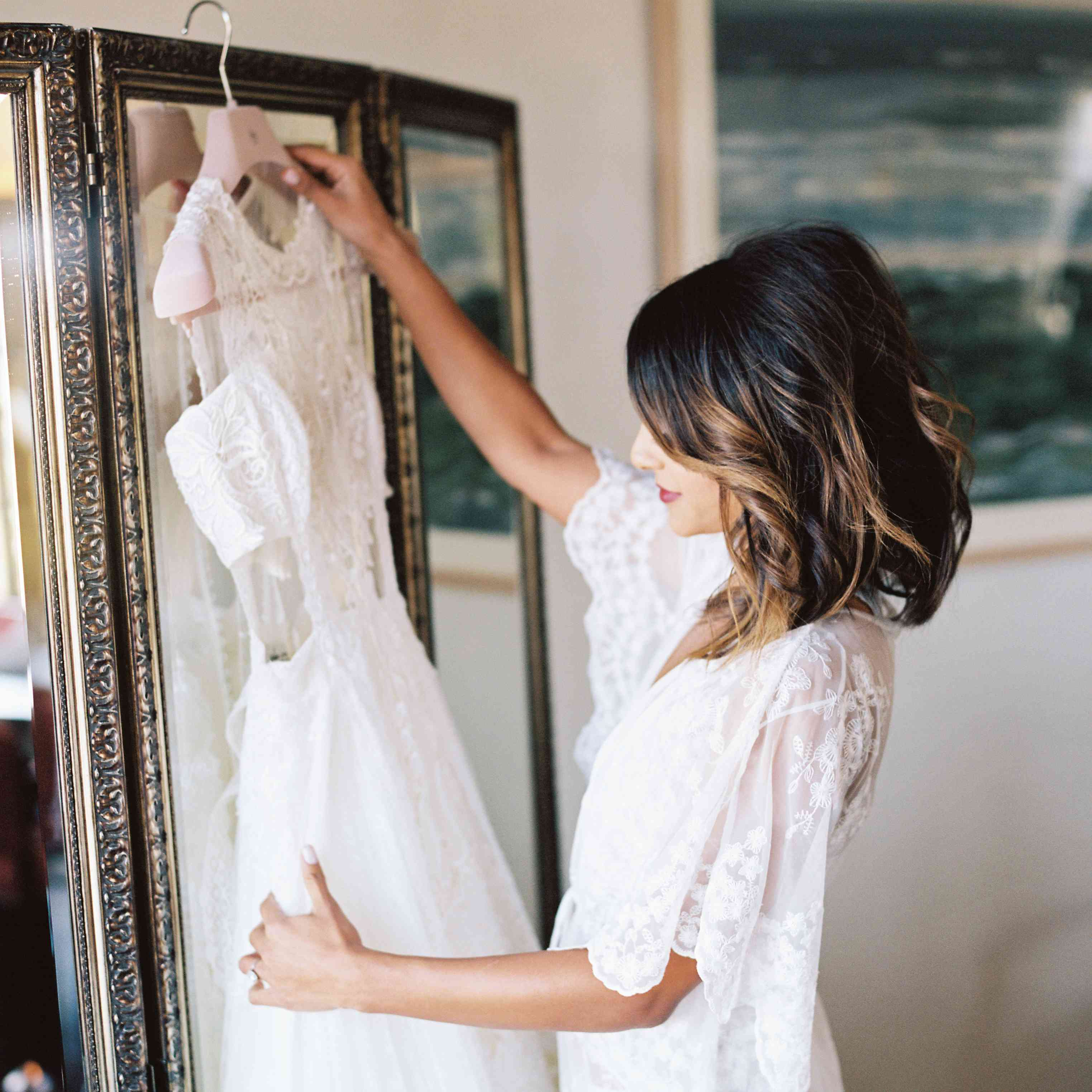 bride getting ready looking at dress