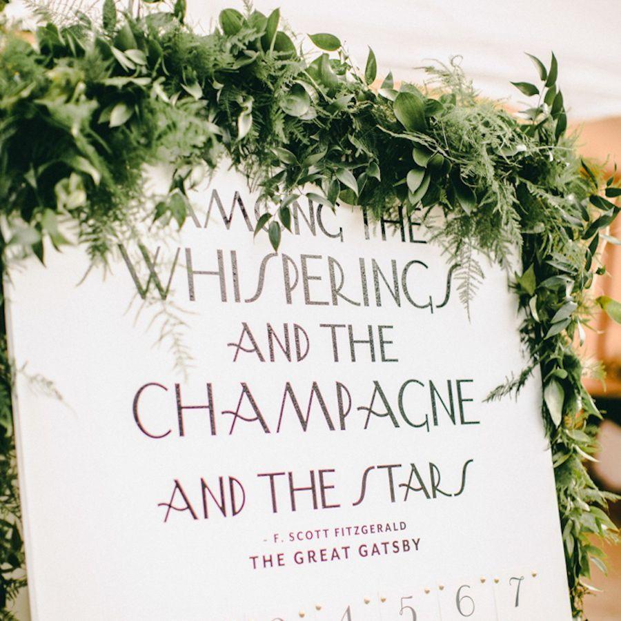 Gatsby themed sign at wedding reception