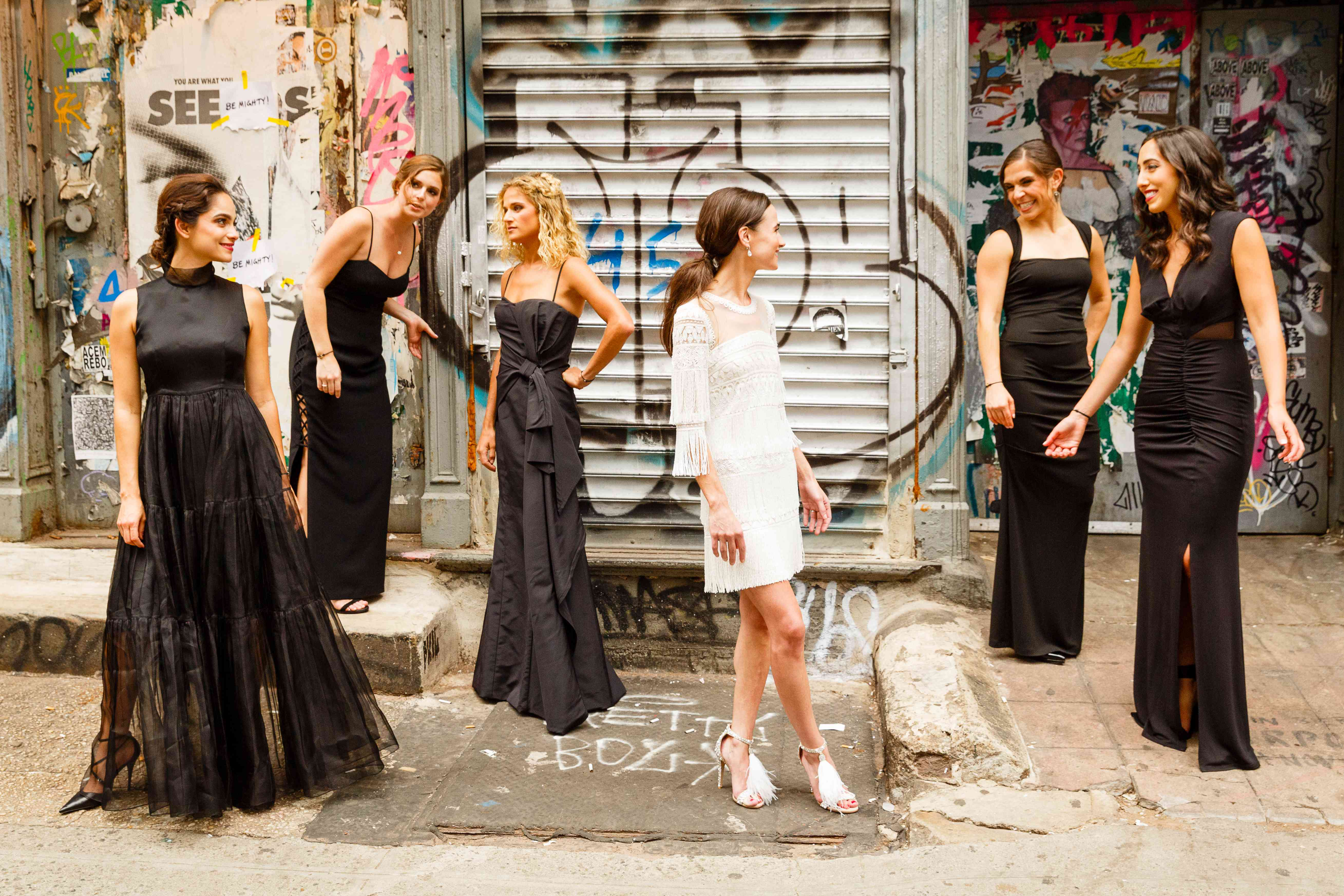bridesmaids in mismatched black evening gowns